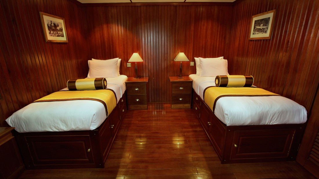 With a passenger capacity of 32, the ratio of guests to staff is almost one to one. Cabins sleep one or two and feature brass fittings and polished teakwood paneling.