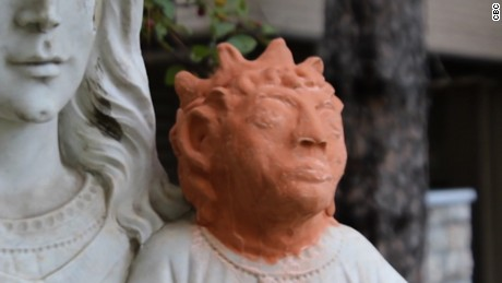 The temporary baby Jesus head, made from terracotta clay, has drawn comparisons to cartoon character Maggie Simpson.