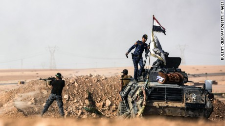 Iraqi pro-government forces hold a position south of Mosul on Friday.