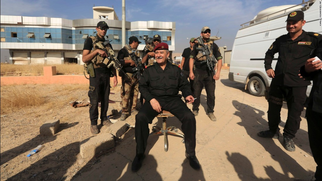 Gen. Abdel Ghani al-Asadi, who leads Iraq's counterterrorism forces, sits in Bartella on Friday, October 21 after the town was reclaimed.