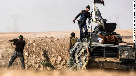 Iraqi forces hold position on the frontline near Tall al-Tibah on Friday