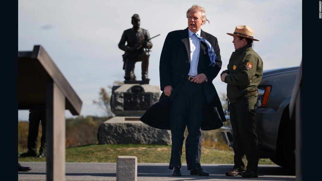 Interpretive park ranger Caitlin Kostic, right, gives a tour near the high-water mark of the Confederacy at Gettysburg National Military Park to Republican presidential nominee Donald Trump, Saturday, October 22.