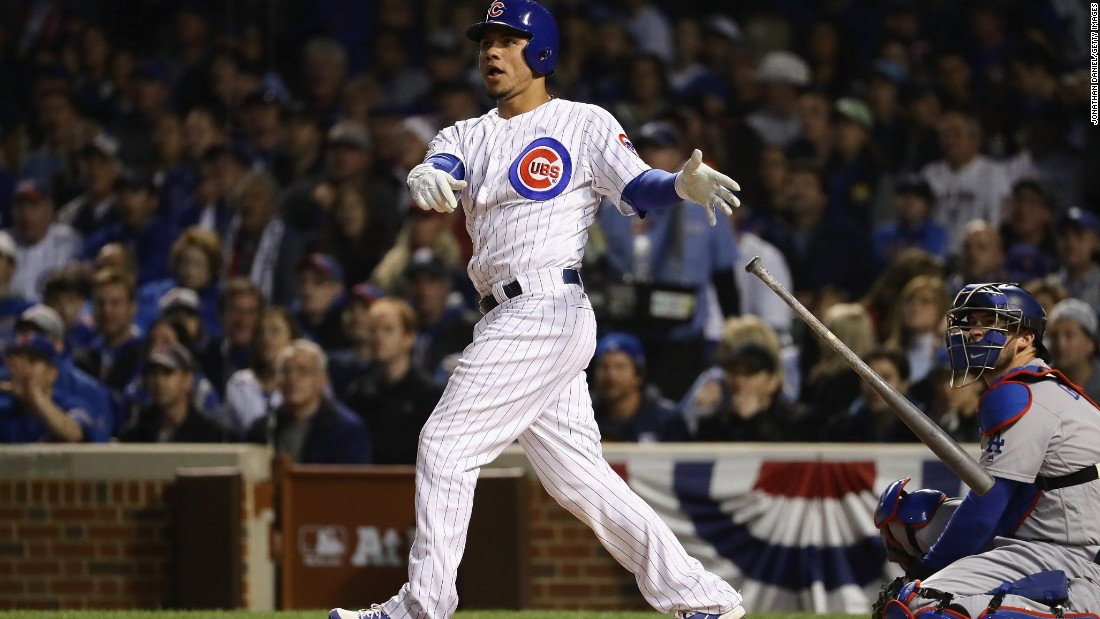Willson Contreras of the Chicago Cubs hits a solo home run in the fourth inning.