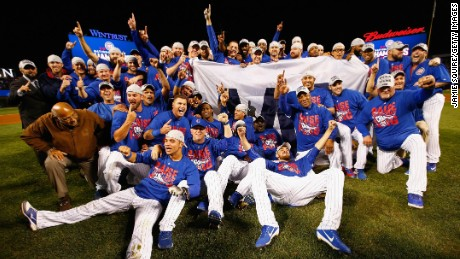 The Chicago Cubs pose after defeating the Los Angeles Dodgers to advance to the World Series.