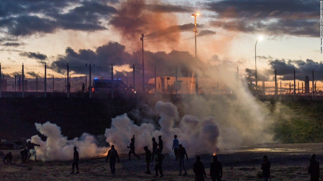 French police fire tear gas after refugees reportedly threw rocks at police vans near the camp on Saturday, October 22.