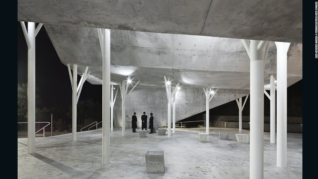 Made of 300 stone panels, the pavilion roof is held up by tree-shaped metal pillars. The architects also built a line of concrete that ascends from one side of the pavilion and returns to the ground on the other to symbolize man's return to dust,