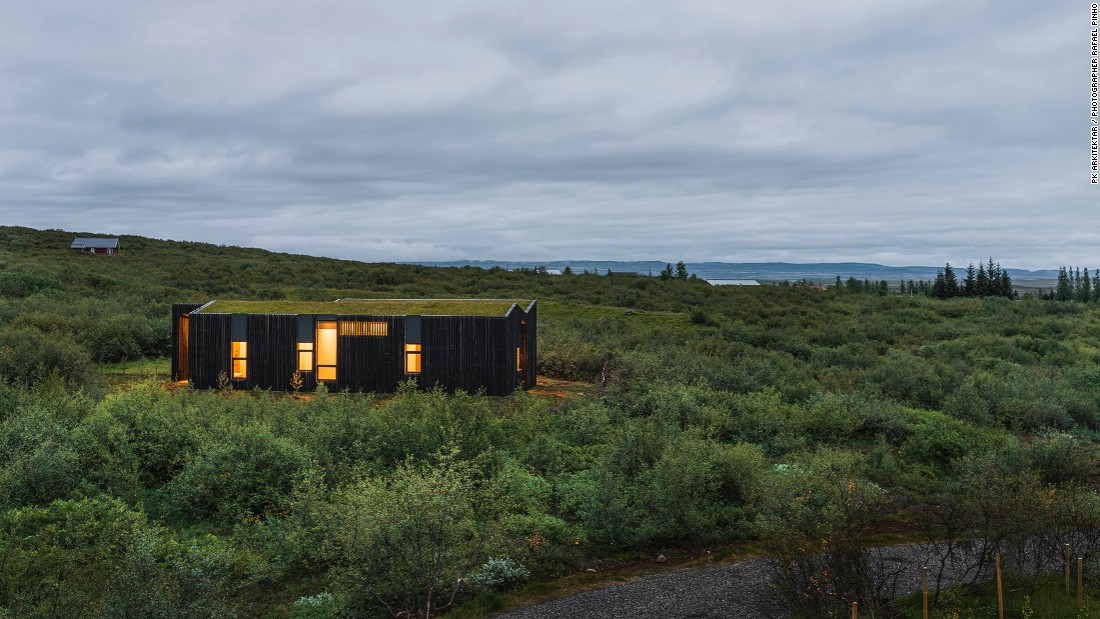 Tucked away in a lush hillside of Brekkuskógur, Iceland, BHM Vacation Rental Cottages by PK Arkitektar blend into the surrounds, thanks to burnt hardwood paneling and green rooftops that seem to fuse with the landscape.