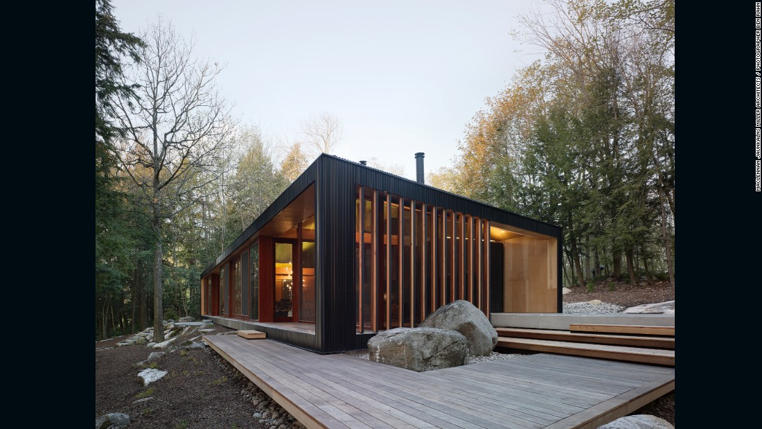 Tucked away in Ontario, Canada, Clear Lake Cottage was built by MacLennan Jaunkalns Miller Architects for a family of five. The year-round getaway captures the warmth of a cozy cottage yet features contemporary design, with clean lines and a sloped roof that was inspired by a circus tent.