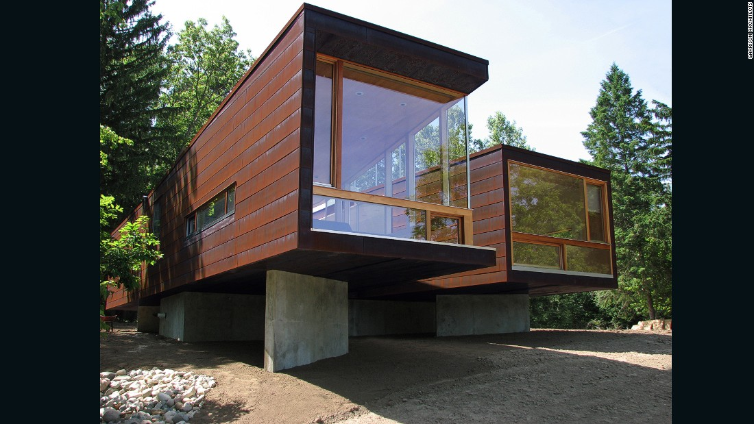 "Designed by Garrison Architects as a boarding school guesthouse, Koby Cottage is a modular residence that takes the shape of an ""X,"" with two modules connected by a glass crossing."