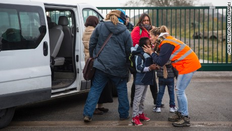 CALAIS, FRANCE - OCTOBER 24: Care workers bring child migrants to a reception point outside the Jungle migrant camp before boarding buses to refugee centres around France on October 24, 2016 in Calais, France. French authorities have begun to clear the estimated 7000 people from the Jungle migrant and refugee camp ahead of its demolition. (Photo by Jack Taylor/Getty Images)