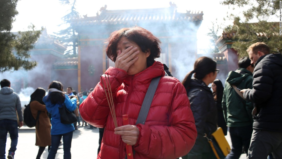 Two years after Malaysia Airlines Flight 370 went missing, a relative of one of the passengers burns incense in Beijing on March 8, 2016. Flight 370 vanished on March 8, 2014, as it flew from Kuala Lumpur, Malaysia, to Beijing. There were 239 people on board.