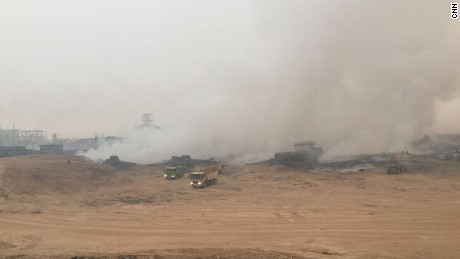 Emergency services are working to extinguish the fire at the sulfur facility near Qayyara.