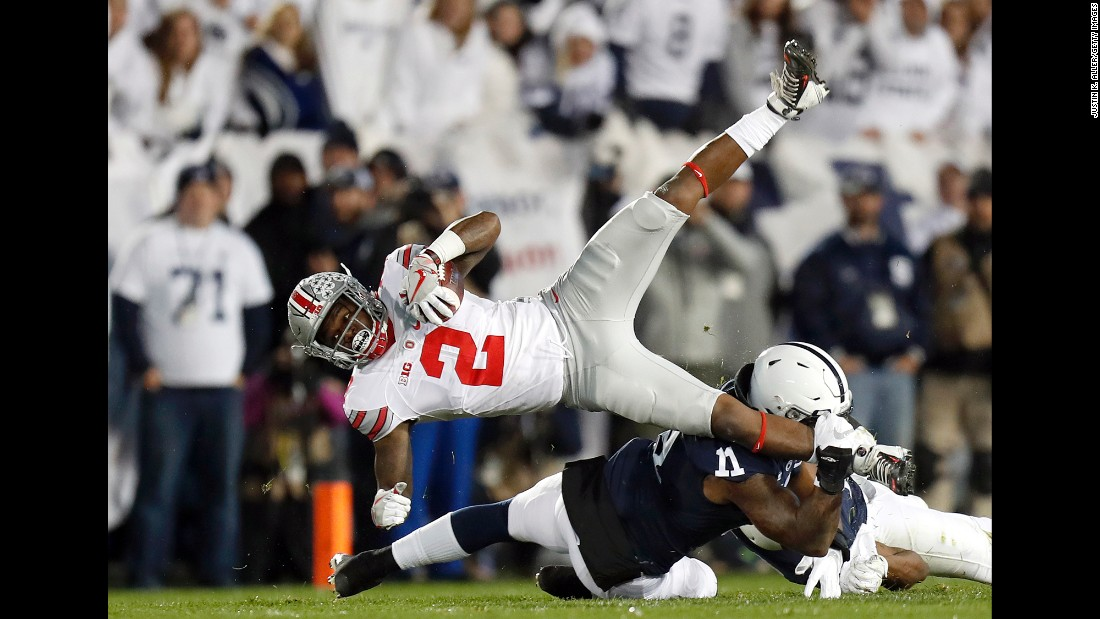 Penn State's Brandon Bell tackles Ohio State's Dontre Wilson during a college football game in State College, Pennsylvania, on Saturday, October 22. Penn State upset the No. 2 Buckeyes 24-21.