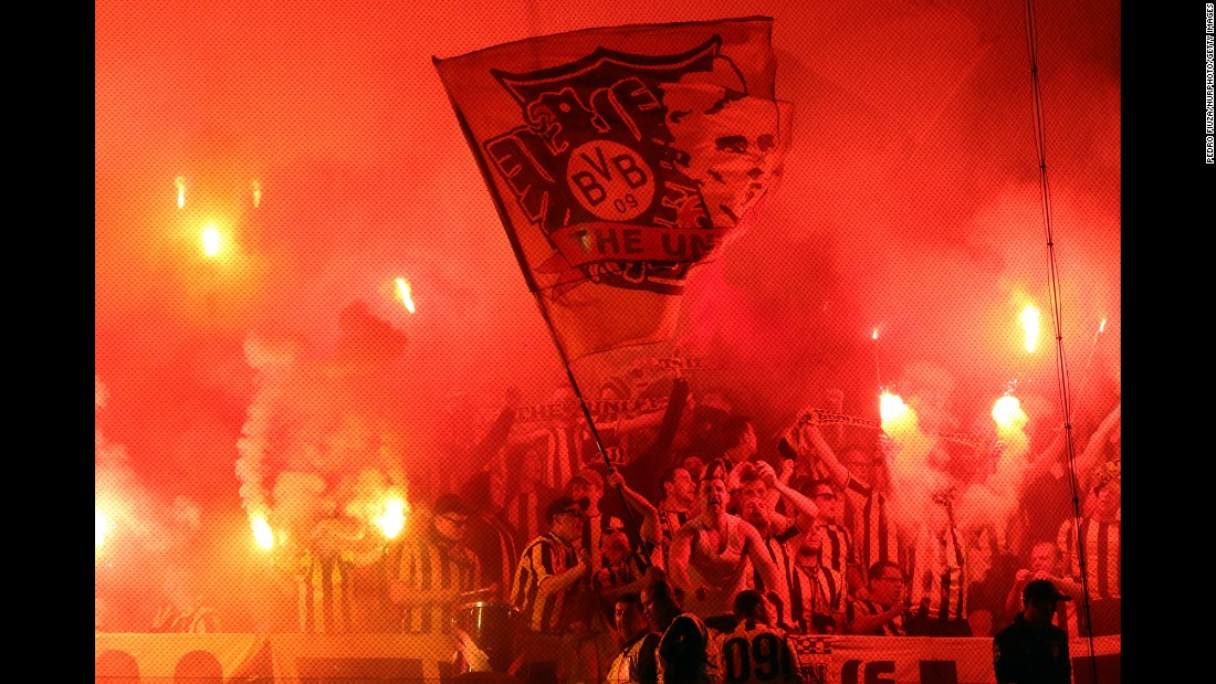 Supporters of the German soccer club Borussia Dortmund light flares during a Champions League match in Lisbon, Portugal, on Tuesday, October 18.