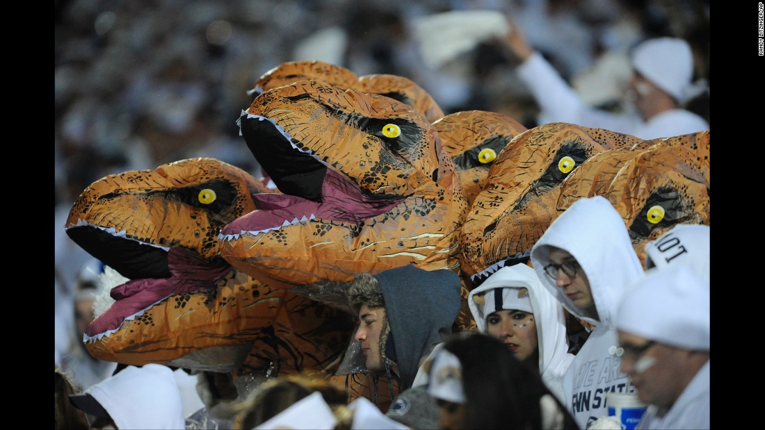 Dinosaur heads are seen in the Penn State student section during the football game against Ohio State on Saturday, October 22.