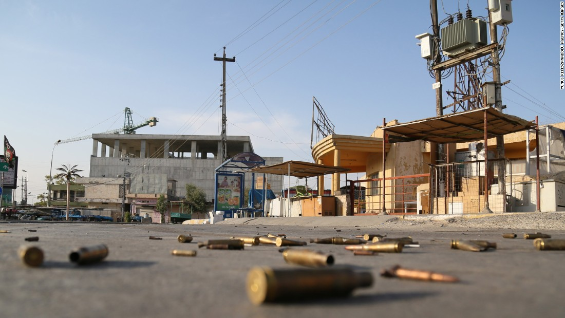 Spent bullet cartridges litter the street around the Jihad Hotel on October 22, where ISIS militants battled Iraqi security forces in Kirkuk the previous day.