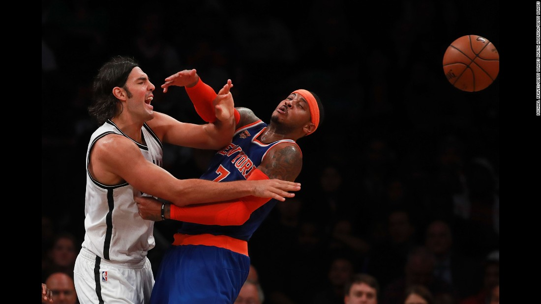 Brooklyn's Luis Scola, left, knocks the ball away from New York's Carmelo Anthony during an NBA preseason game on Thursday, October 20.