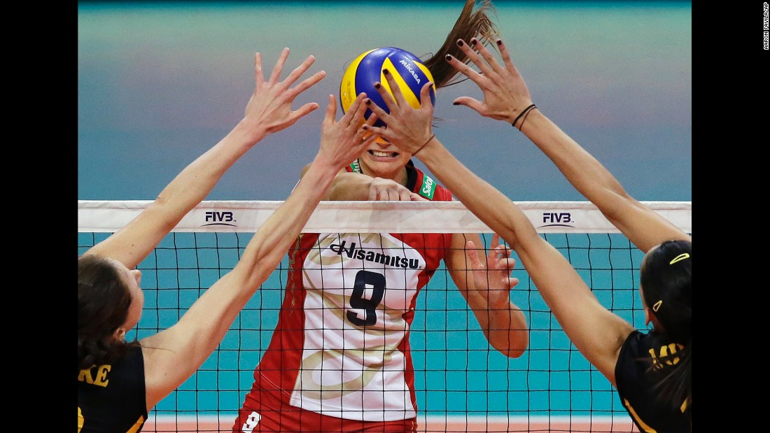 Lonneke Sloetjes, left, and Milena Rasic -- two players with VakifBank Istanbul -- block the shot of Hisamitsu Springs' Maja Tokarska during a volleyball match in Pasay, Philippines, on Tuesday, October 18.