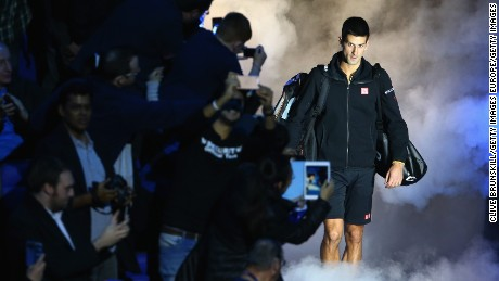 LONDON, ENGLAND - NOVEMBER 10:  Novak Djokovic of Serbia walks out on court to play against Marin Cilic of Croatia in their round robin match during the Barclays ATP World Tour Finals at the O2 Arena on November 10, 2014 in London, England.  (Photo by Clive Brunskill/Getty Images)