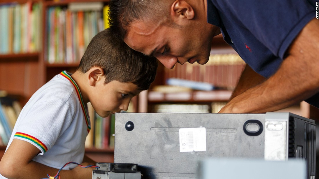 He set up the Foundation in 2001. Pictured, children learn about computers at Senderos de Paz, a home for Colombian children outside Medellin.