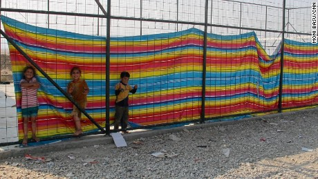 Children play in a shielded compound where women, traumatized by their experiences under ISIS, feel more protected.