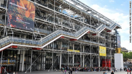 People stand in line in front of the Pompidou Centre modern art museum on June 7, 2009 in Paris, during a private visit of US President Barack Obama and his family. The president was due to fly back to Washington later today, but the rest of the family was expected to stay on in Paris for a short private visit. On Saturday night the visitors were cheered by huge crowds as they visited the Gothic splendour of the Notre Dame cathedral, and then went on to dine privately in a traditional bistro. AFP PHOTO MIGUEL MEDINA (Photo credit should read MIGUEL MEDINA/AFP/Getty Images)