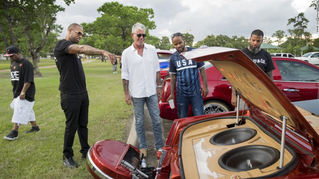 In Houston, musician Slim Thug (second from left) gave Bourdain a primer on Slab, the city's unique car culture. Among the key slab requirements? Candy-colored paint and elbow rims.