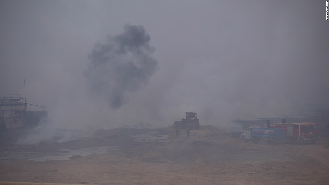 Hazardous chemical clouds fill the air at the sulfur factory near Qayyara on October 25.
