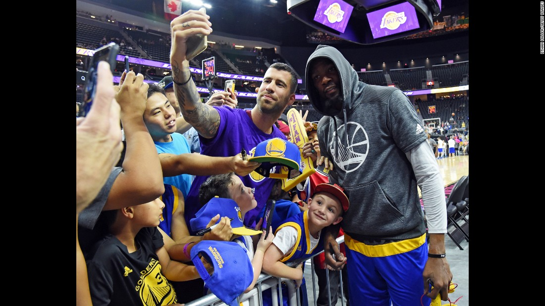 Basketball star Kevin Durant stops for a fan's photo before a preseason game in Las Vegas on Saturday, October 15.