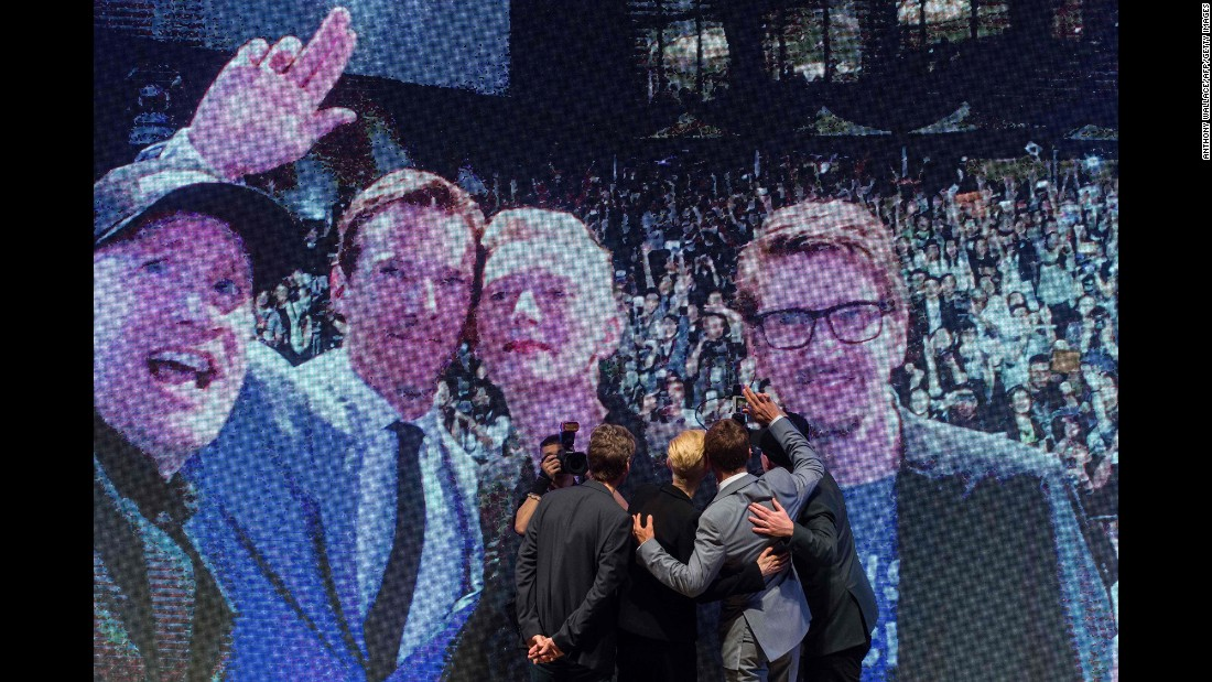 "A video screen shows an on-stage selfie at a ""Doctor Strange"" event in Hong Kong on Thursday, October 13. On the screen, from left, are Marvel Studios President Kevin Feige, actor Benedict Cumberbatch, actress Tilda Swinton and ""Doctor Strange"" director Scott Derrickson. <a href=""http://www.cnn.com/2016/09/28/entertainment/gallery/look-at-me-selfies-september/index.html"" target=""_blank"">See 15 must-see selfies from September</a>"