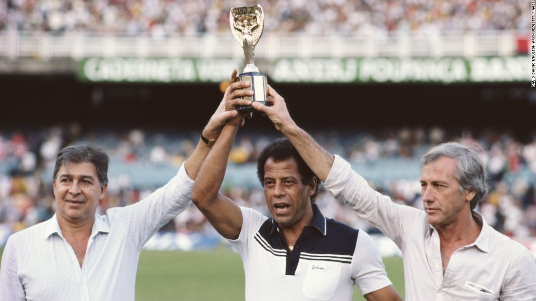 Alberto is pictured lifting the Jules Rimet FIFA World Cup trophy, alongside former Brazilian winning captains Mauro Ramos (1962) and Hilderaldo Bellini (1958) at the Maracana Stadium.