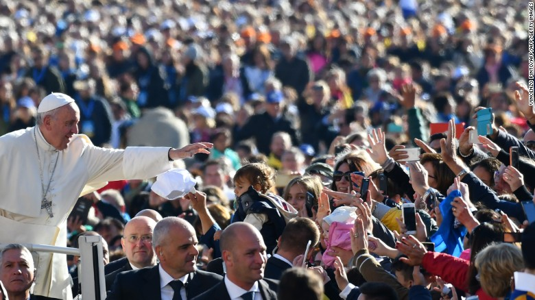 Pope Francis greets the crowd in St. Peter's square.