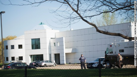 Police stand guard at Paisley Park, the home and studio of Prince, on April 22, 2016 in Chanhassen, Minnesota.