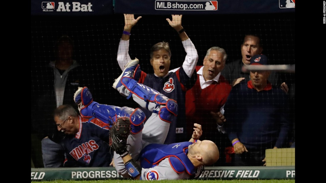 Cubs catcher David Ross falls after catching a pop fly by Cleveland's Lonnie Chisenhall in Game 1.