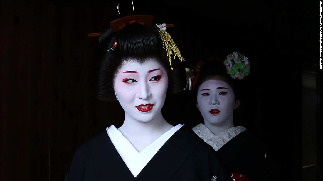 "Though geisha can be found throughout Japan,  Kyoto is considered the birthplace of geisha culture. A maiko apprentice needs to study for at least five years before she's considered skilled and mature enough to become a full-fledged geisha. <a href=""http://edition.cnn.com/2014/06/30/travel/geisha-hunting-kyoto/"">How to tell the difference?</a> A maiko will have decorations, like flowers, in her hair."