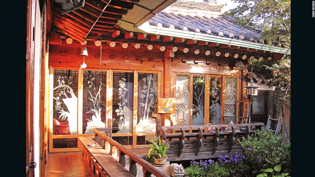 "Hanoks' pagoda-style roofs, eaves and intricate woodwork are becoming harder to find in South Korea. Traditional buildings that remain are under threat from rising property prices and Korea's ongoing modernization. In Seoul, original hanoks are concentrated in Buckchon, a so-called ""hanok village""."