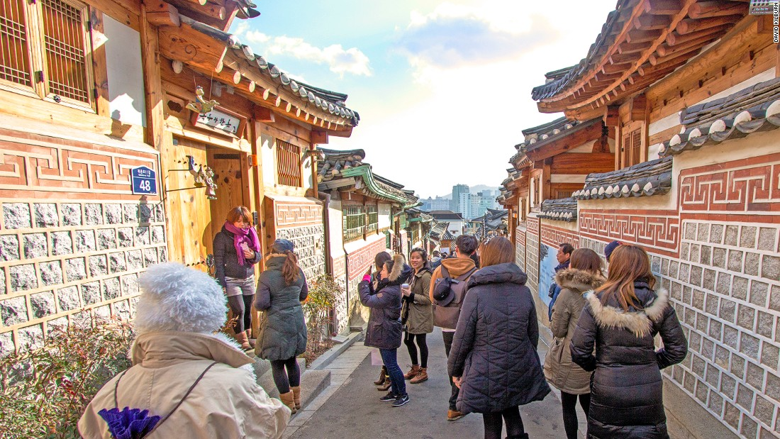 "This photo of Seoul's last hanok-only street was taken by David Kilburn, a British expatriate and hanok expert who campaigns for their preservation. ""A city the size of Seoul, with the wealth of Seoul, should find it within its resources to protect and preserve at least one street of traditional houses to show how people lived and worked a hundred or more years ago,"" he says."