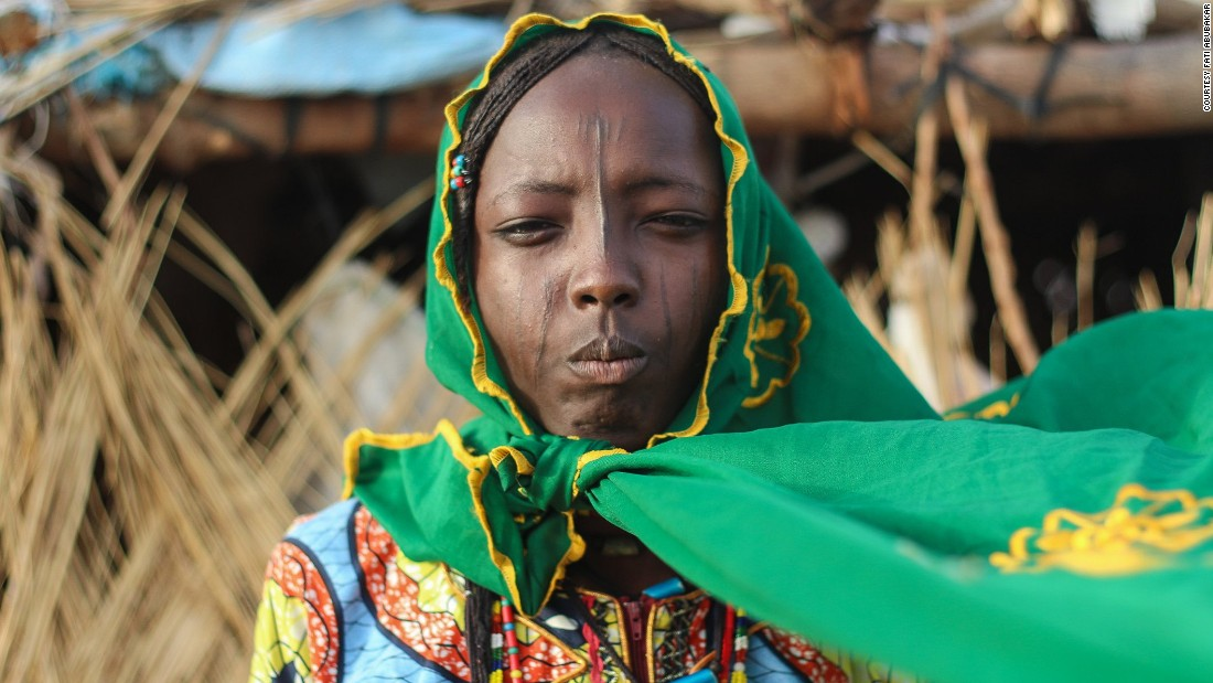 """A Kwayam girl in the Dalori nomadic community. Northern Nigeria has become synonymous with car bombings, kidnappings and forced child marriages in the wake of Boko Haram. Born and raised in Maiduguri, 30-year-old Fati Abubakar has been capturing residents living under the Islamic militants shadow. Her Instagram account <a href=""""https://www.instagram.com/bitsofborno/"""" target=""""_blank"""">@bitsofborno</a> aims to document everyday life in Borno State, an area known for frequent Boko Haram attacks. While acknowledging the fear and violence that Boko Haram has caused, her images focus on hope and resilience."""