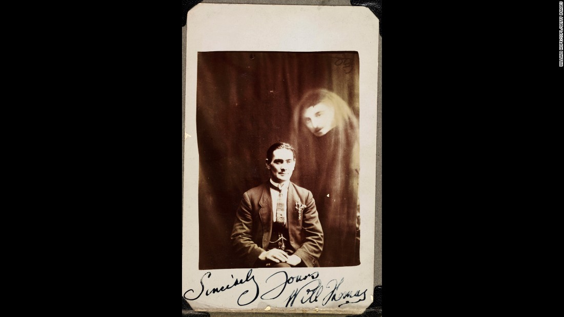 A man's face appears in a haze of drapery next to Will Thomas, a medium from Wales in the early 20th century. The photo was taken by William Hope, a paranormal investigator who was popular for his spirit photography in England. His photos of supposed ghosts were later proved to be fake -- the result of double- and triple-exposure techniques -- but he continued the practice until his death in 1933.