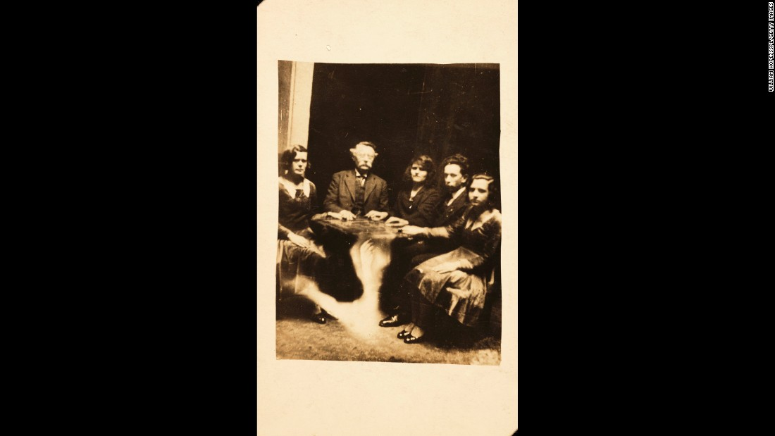 "A table is seemingly lifted by a ghostly arm during a seance. Harry Price, from the Society of Psychical Research, reported on Hope's deception in 1922. There was also <a href=""https://babel.hathitrust.org/cgi/pt?id=pst.000063000252;view=1up;seq=664"" target=""_blank"">an article</a> in Scientific American magazine that year that called Hope ""a common cheat who obtains money under false pretenses."""