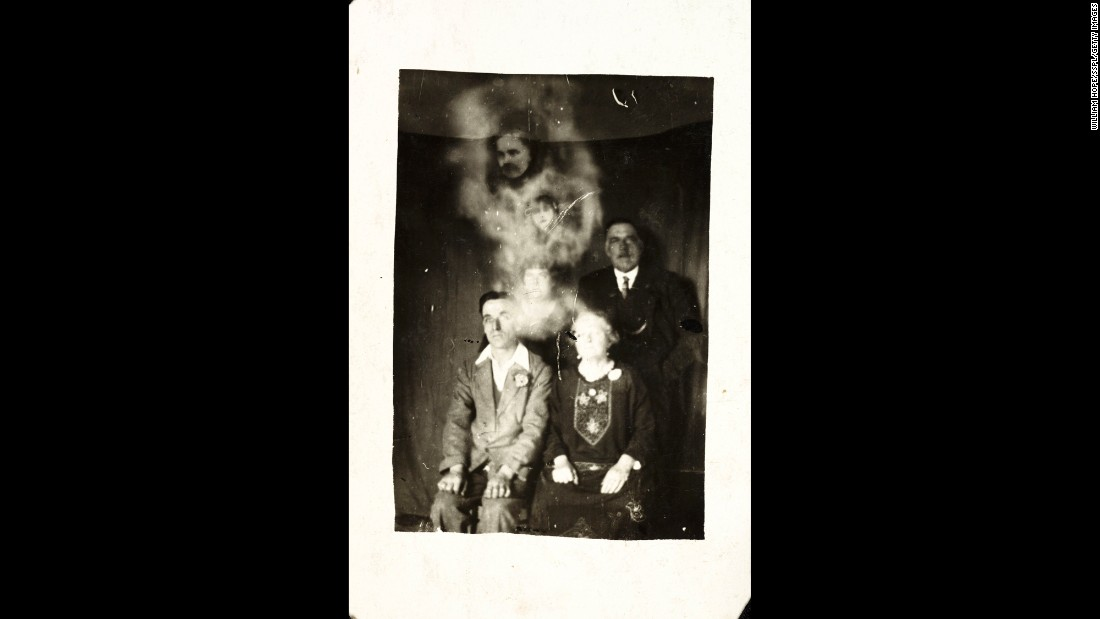 "A ""mist"" shows two faces -- a man and a girl -- in this group photo."