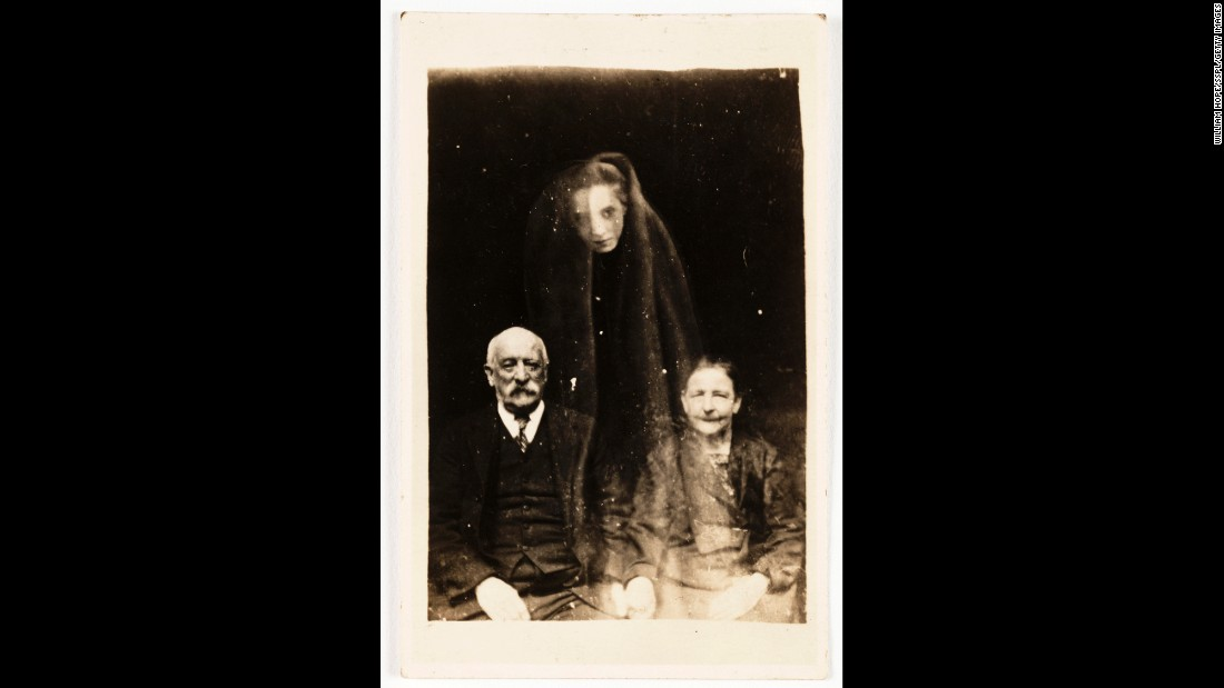 A young woman's face, draped in a cloak, seems to float above an older couple.