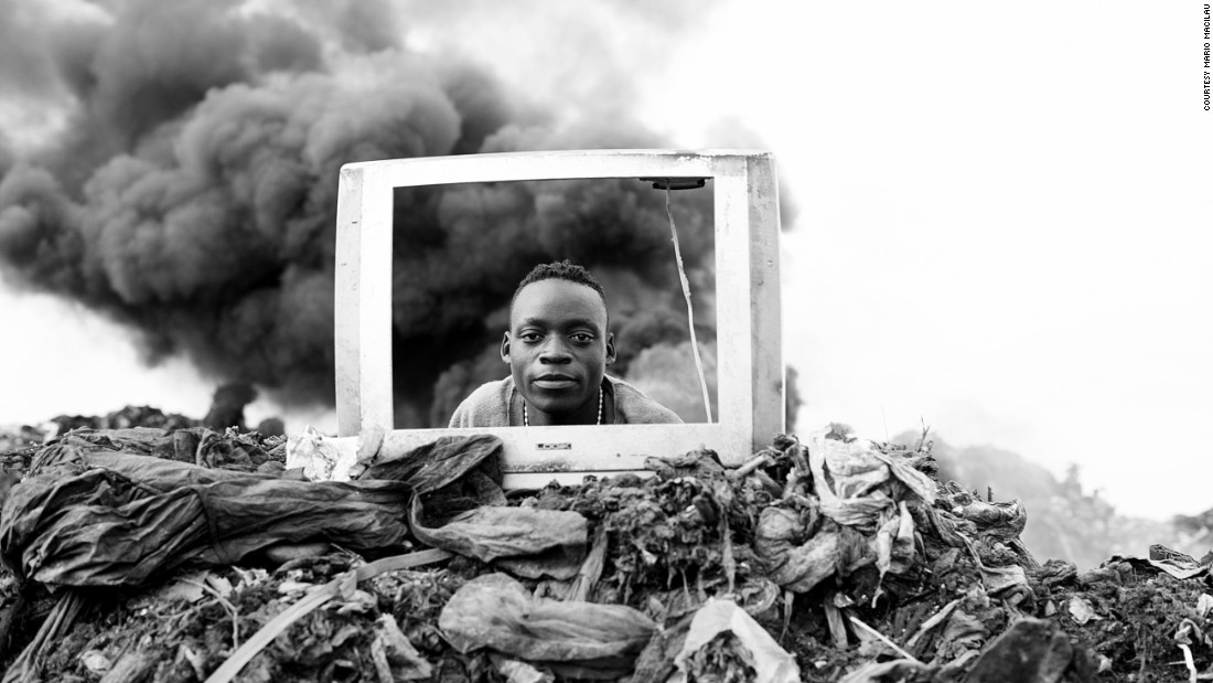 A boy plays behind a discarded TV frame. Electronic waste is burned at the site, explains Macilau, releasing hazardous chemicals into the environment.
