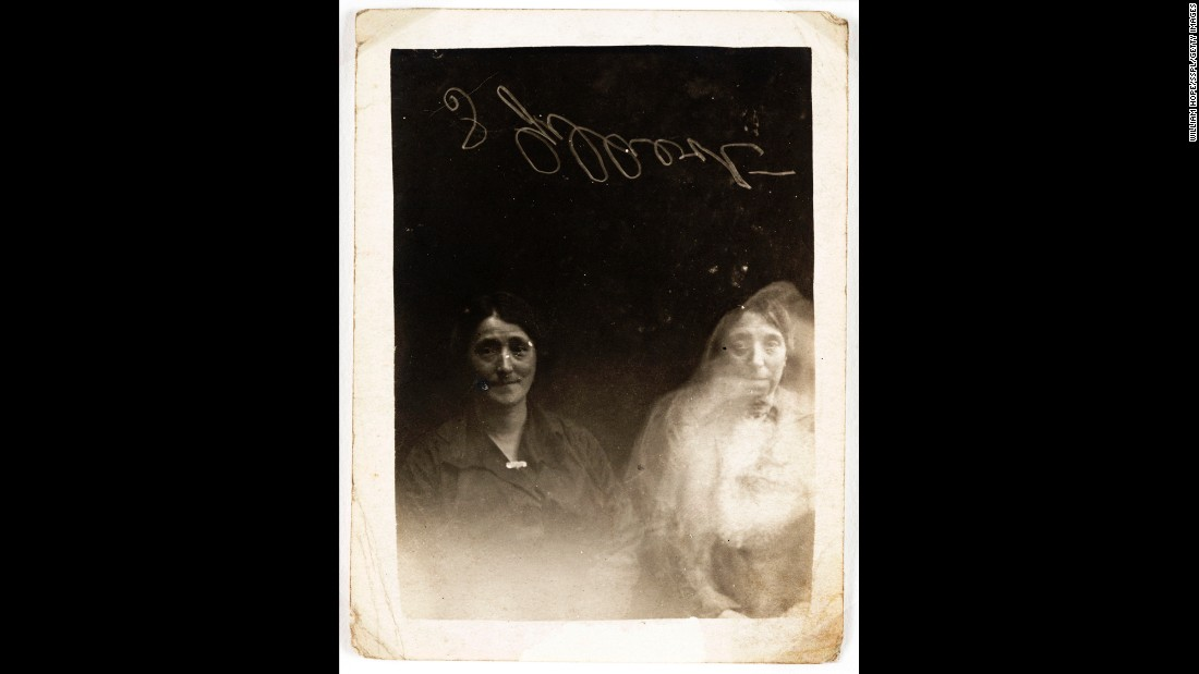 The face of a young woman appears over a woman on the right. One of the people in the photograph signed the plate for authentication.