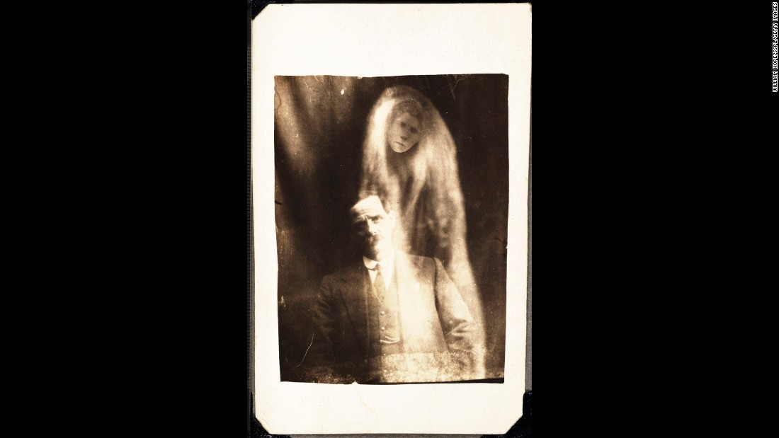 "A woman's face appears in ""misty"" drapes around a man. The man identified it as his deceased second wife."