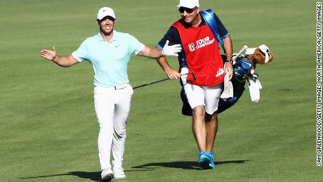 McIlroy and caddy J.P. Fitzgerald celebrate after an eagle at the Tour Championship in September.
