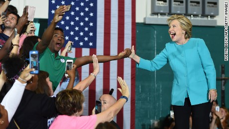 A supporter takes a selfie as he touches hands with Democratic presidential nominee Hillary Clinton at a rally at Palm Beach State College in Lake Worth, Florida, October 26, 2016.