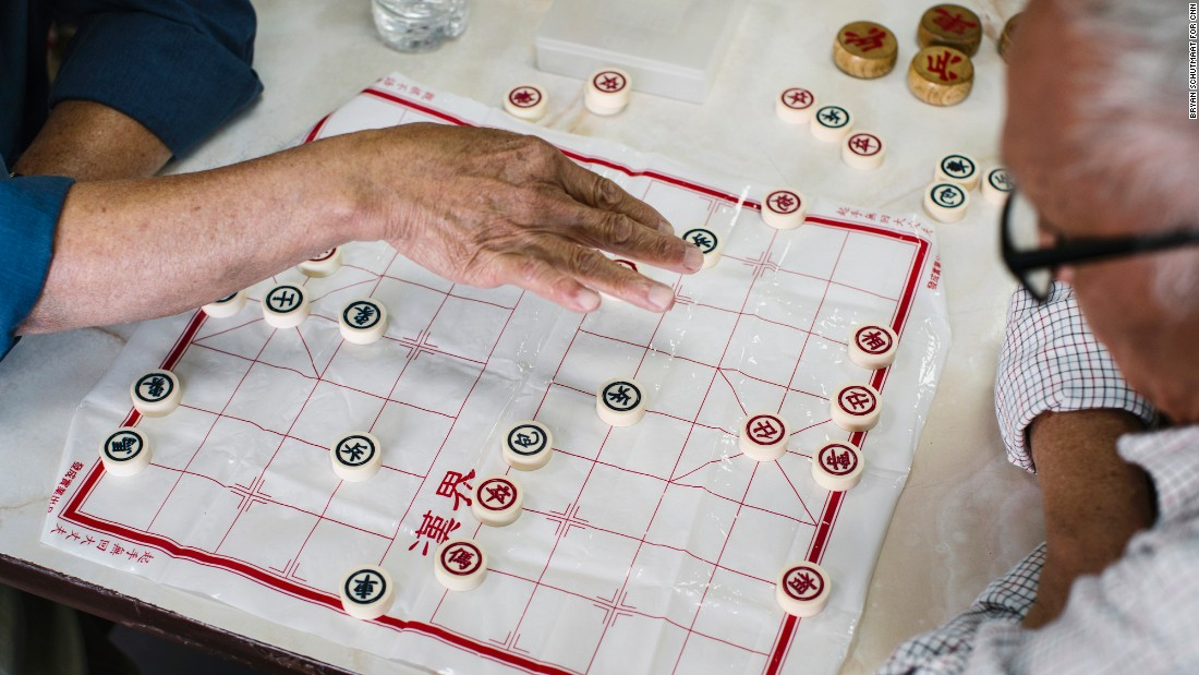 Men play xiangqi in the food court of Hong Kong City Mall in Houston. The city's Chinatown is 12 miles southwest of downtown.