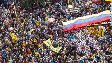 People protest against the government of Venezuelan President Nicolas Maduro in Porlamar, Margarita Island on October 26, 2016.  Venezuela's opposition ratcheted up the pressure on President Nicolas Maduro at mass protests, announcing plans for a general strike, a new march and a legislative onslaught. More than 20 people were injured and 39 were detained at anti-government protests, the head of a local rights group said.       / AFP / STR        (Photo credit should read STR/AFP/Getty Images)