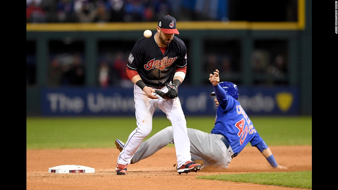 Jason Kipnis of the Indians is unable to handle the ball as Willson Contreras of the Cubs slides safely into second during the seventh inning in Game 2.